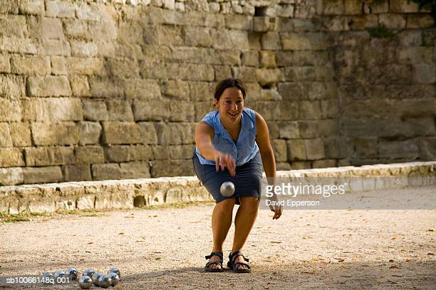Woman playing popular French game of Boules