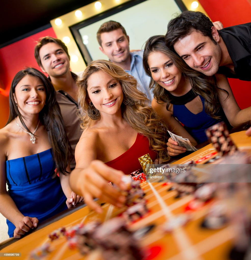 Woman playing roulette : Stock Photo