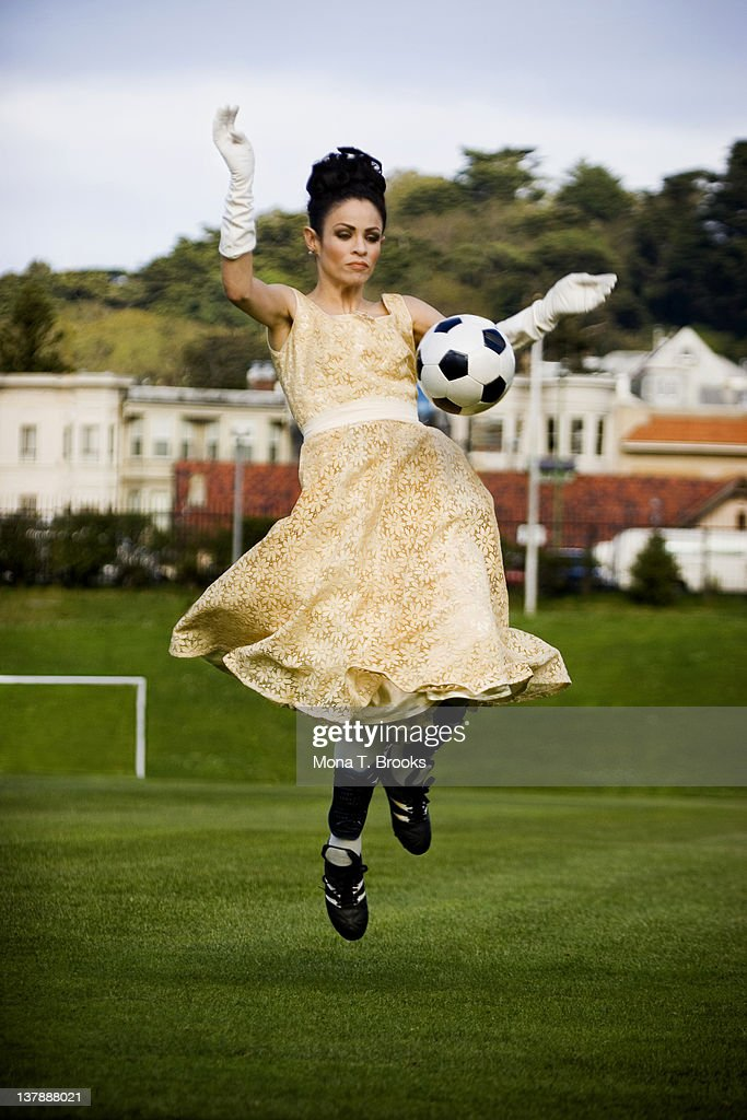 Woman playing soccer : Stock Photo