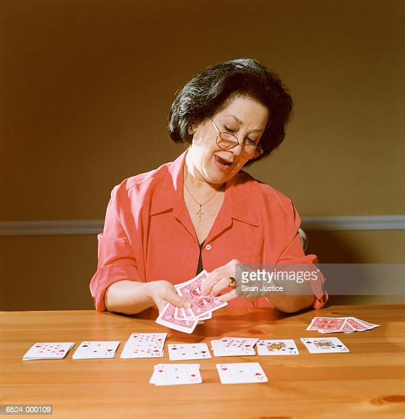 Woman Playing Solitaire