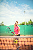 Tennis player with balls and racket.