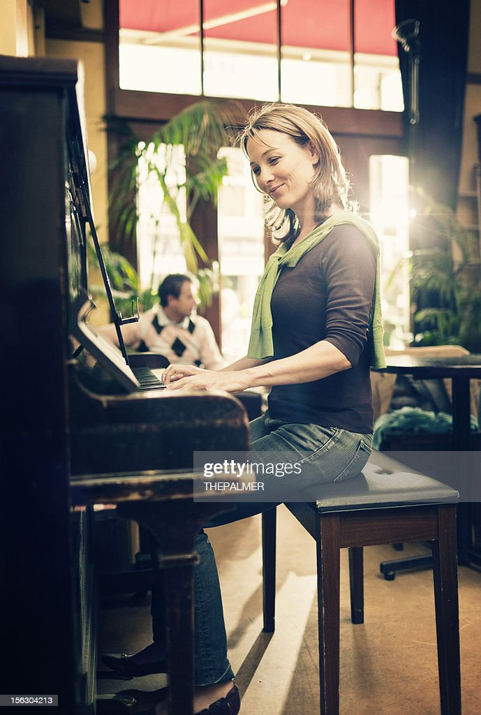 woman playing the piano : Stock Photo