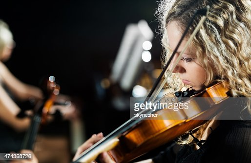Woman playing the violin.