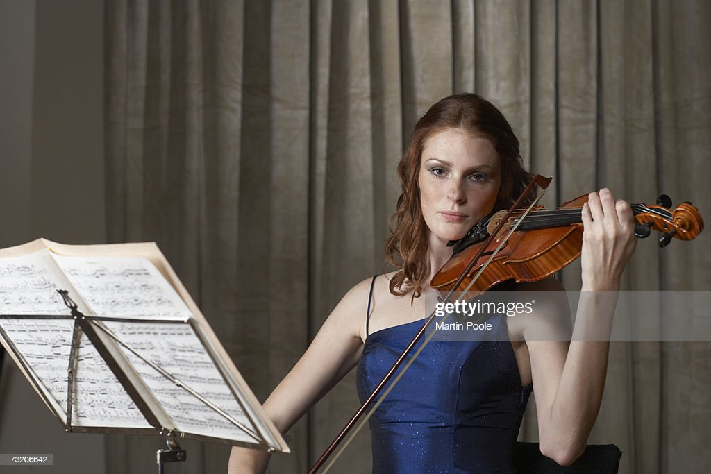 Woman playing violin, upper half : Stock Photo