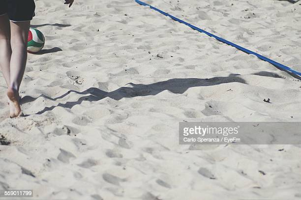 Woman Playing Volleyball On Beach