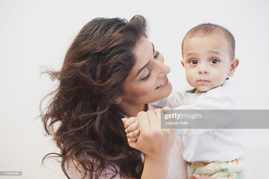 Woman playing with her baby son : Stock Photo