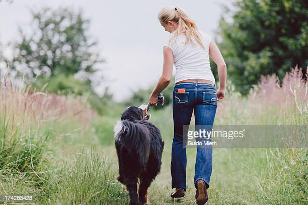 Woman playing with her dog outdoor.