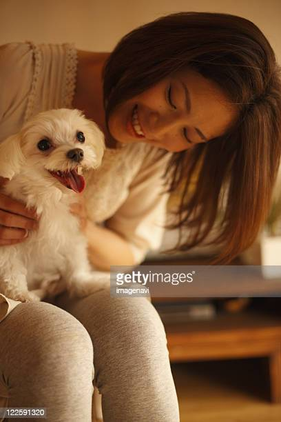A woman playing with her dog