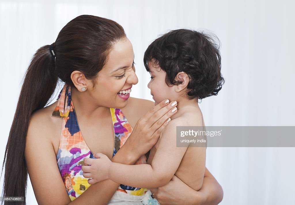 Woman playing with her son : Stock Photo