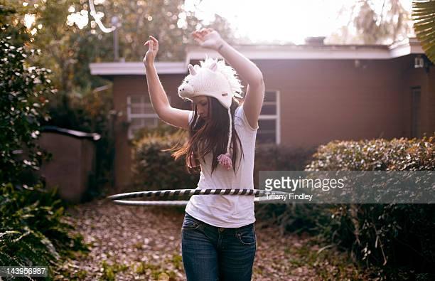 Woman playing with hula hoop