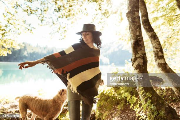 woman playing with the dog in the mountain