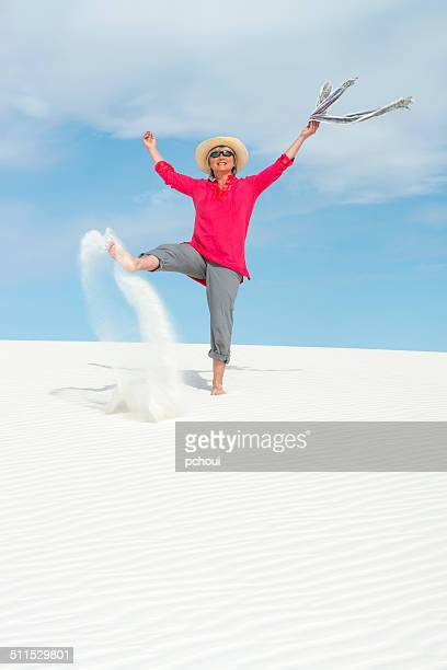 Woman playing with white sand
