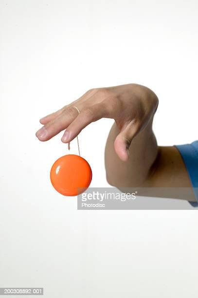 Woman playing with yo-yo, close-up of hand, close-up
