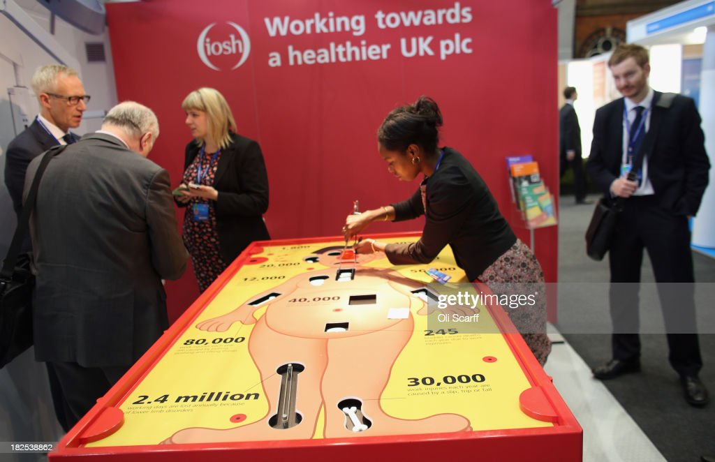 A woman plays a giant version of the game 'Operation' in the Central Hall Foyer of Manchester Central on the second day of the Conservative Party Conference on September 30, 2013 in Manchester, England. Chancellor of the Exchequer George Osborne has unveiled a Government plan for long-term unemployed people to undertake work placements in order to receive their benefits.