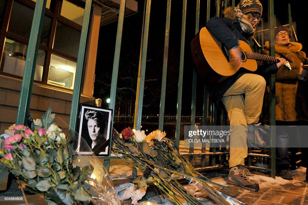 A woman plays guitar during a memorial event for British singer <a gi-track='captionPersonalityLinkClicked' href=/galleries/search?phrase=David+Bowie&family=editorial&specificpeople=171314 ng-click='$event.stopPropagation()'>David Bowie</a> at consulate of Great Britain in St Petersburg on January 11, 2016. <a gi-track='captionPersonalityLinkClicked' href=/galleries/search?phrase=David+Bowie&family=editorial&specificpeople=171314 ng-click='$event.stopPropagation()'>David Bowie</a> died on the 70th year of life. On January 8 he was 69 years old, specially to this date the singer let out the 25th album. / AFP / OLGA