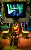 A woman plays Pac Man World 3 powered by an XBox 360 game console in the Microsoft Corp exhibit area at the 11th annual Electronic Entertainment Expo...