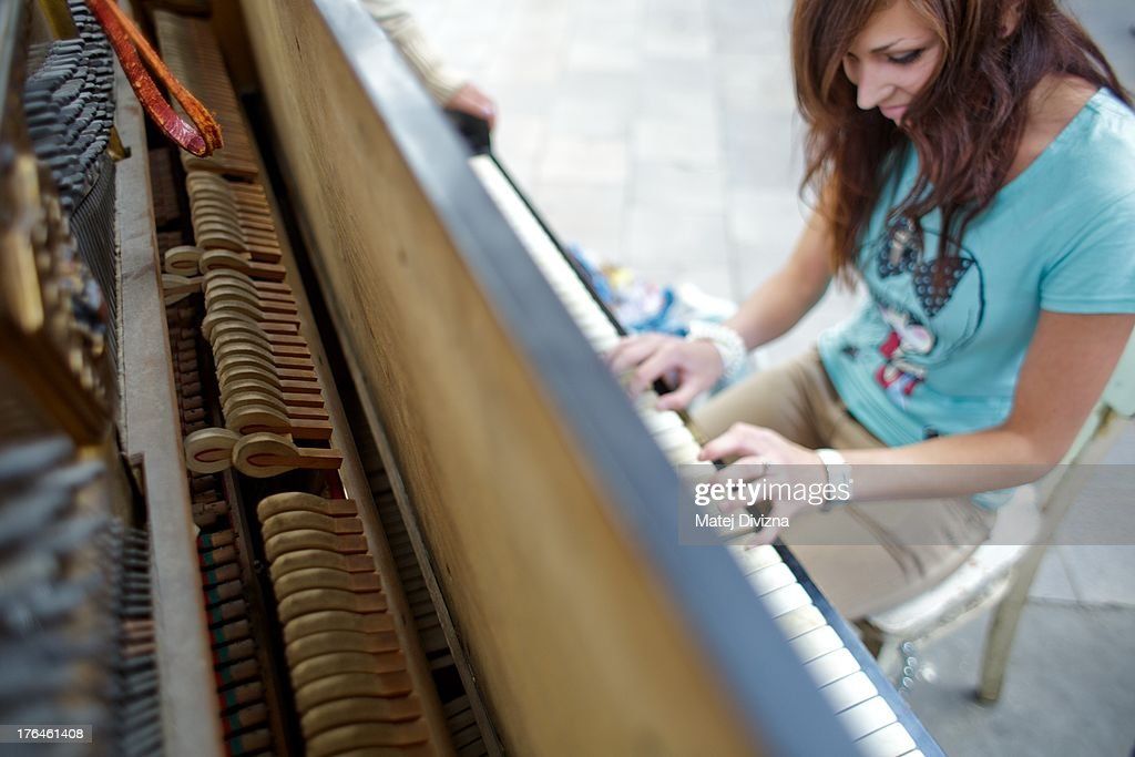 A woman plays piano during the first day of the 'Pianos on the street' project at the Masaryk railway station on August 13, 2013 in Prague, Czech Republic. The project, by Prague cafe owner Ondrej Kobza, started in Prague today. Kobza placed pianos in five spots in the city centre for random passers-by to play. Similar projects run worldwide.