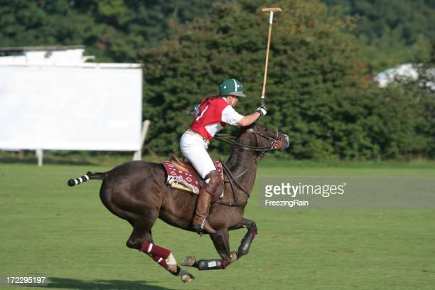 Woman plays polo