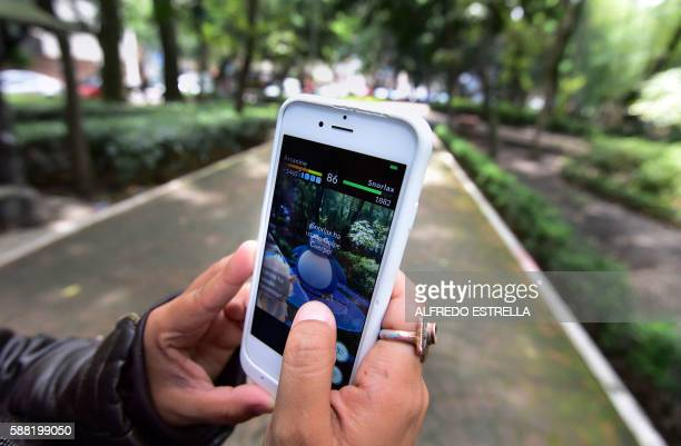 A woman plays the newly launched Pokemon Go game at a public park in Mexico City on August 10 2016 / AFP / ALFREDO ESTRELLA