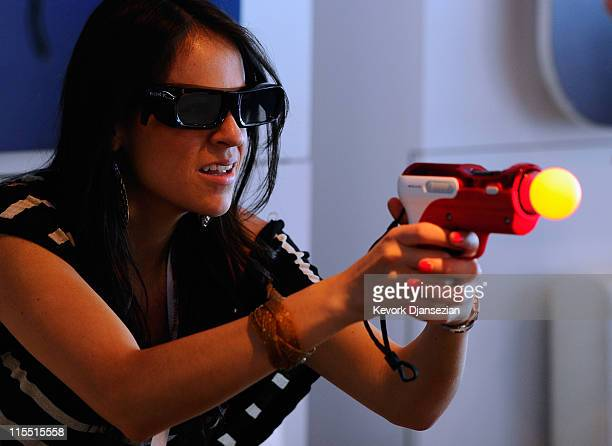 A woman plays video games at the Sony Playstation booth during the Electronic Entertainment Expo on June 7 2011 in Los Angeles California More than...