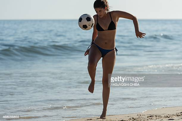 A woman plays with a football at Ipanema beach in Rio de Janeiro Brazil on January 30 2014