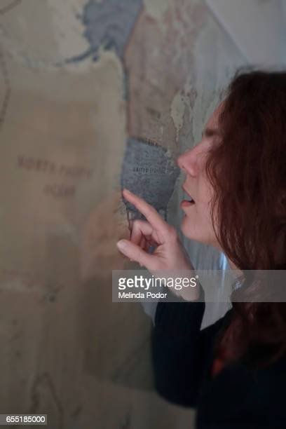 Woman pointing at a map