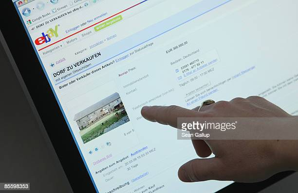 A woman points to the eBay announcement for the auction of the village of Liebon in Saxony on March 25 2009 in Berlin Germany Liebon which dates back...