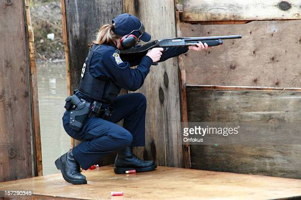Woman Police Officer Shooting Shotgun at the Practice Field