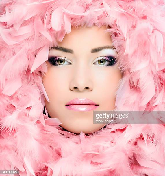 woman portrait and pink feathers