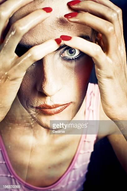 Woman portrait behind glass
