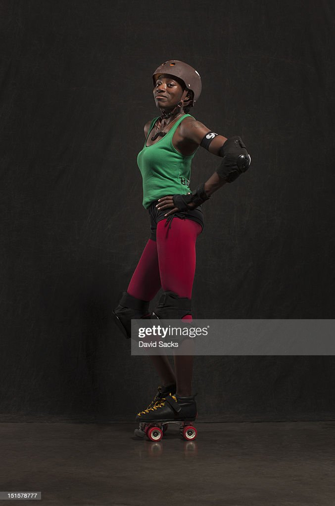 Woman portrait in roller derby gear : Stock Photo