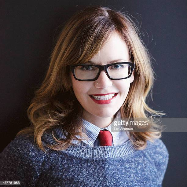 Woman portrait with red tie and dark glasses