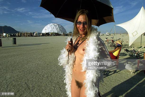 A woman poses at Black Rock City's Burning Man festival in Nevada 02 September 1999 Founded in 1986 by a group of fine artists filmmakers and...