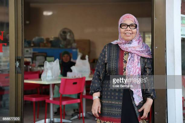 A woman poses for a photograph at the front of her restaurant in the southwestern suburb of Lakemba on May 27 2017 in Sydney Australia Muslims around...