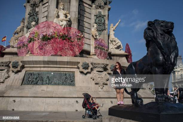 A woman poses for a photograph at the Monument a Colom on October 6 2017 in Barcelona Spain Tension between the central government and the Catalan...