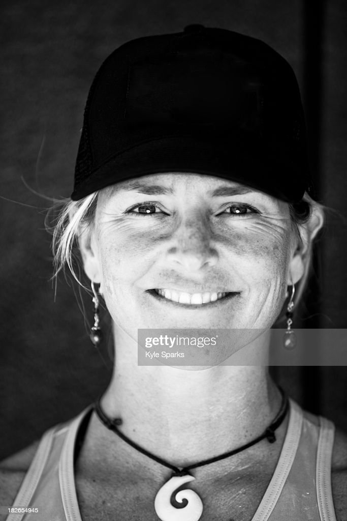 A woman poses for a portrait after paddling a six-person outrigger canoe in Santa Barbara, California. : Stock Photo