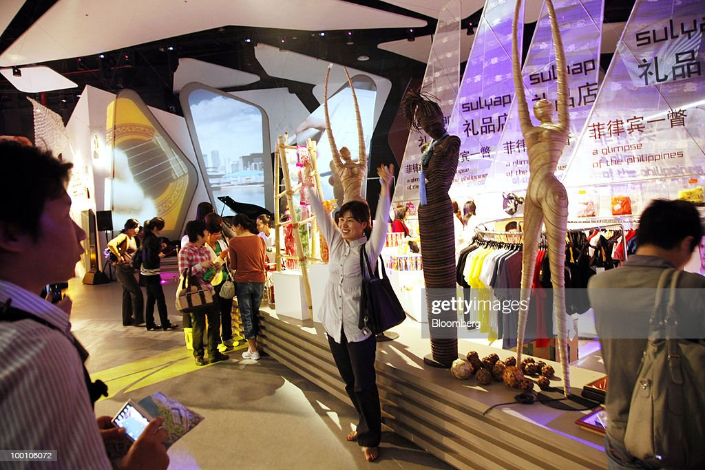 A woman poses for photos at the Philippines Pavilion at the 2010 World Expo site in Shanghai, China, on Thursday, May 20, 2010. The 2010 World Expo will take place until October 31. Photographer: Qilai Shen/Bloomberg via Getty Images