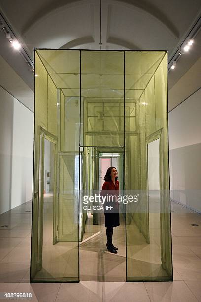 A woman poses for pictures with an artwork entitled 'Wielandstr 18 12159 Berlin' by South Korean artist Do Ho Suh during a photocall in the...