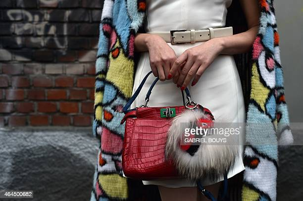 A woman poses in the street before the show for fashion house Fendi at the women Fall / Winter 2015/16 Milan's Fashion Week on February 26 2015 AFP...