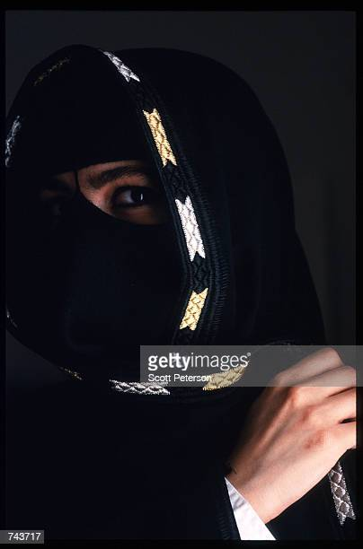 A woman poses July 15 1996 in Saudi Arabia Possessing twentyfive percent of the world's oil reserves and the Islamic shrines of Mecca and Medina the...