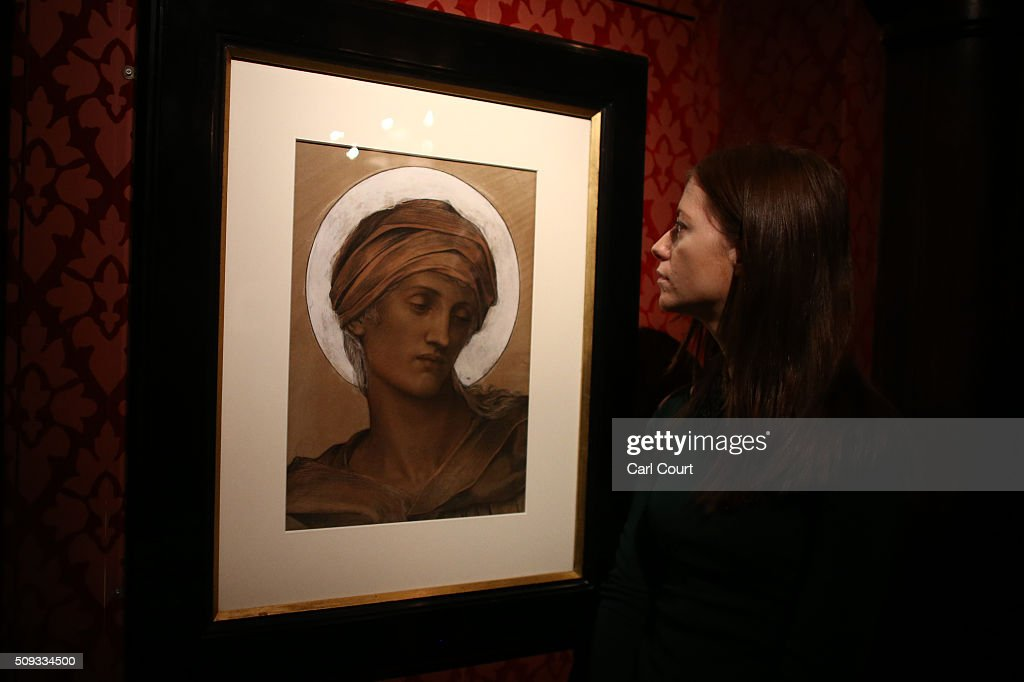 A woman poses next to a picture by Evelyn De Morgan entitled 'Mater Dolorosa' during a preview at Leighton House Museum on February 10, 2016 in London, England. The worst form part of the Pre-Raphaelites on Paper exhibition, which will run from 12th February to 29th May 2016.
