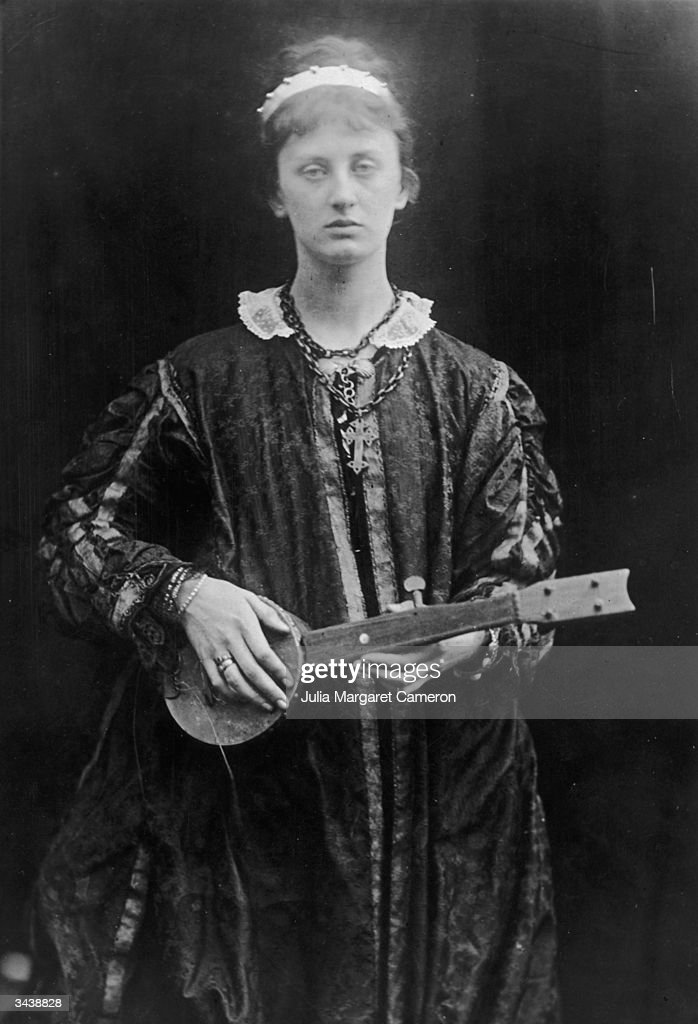A woman poses with a lute as The Princess in a Julia Margaret Cameron recreation of Alfred Lord Tennyson's poem of the same name