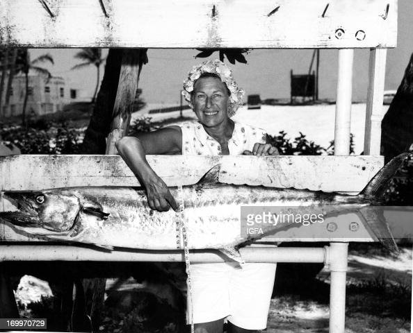 A woman poses with her 52 pound 8 ounce king mackerel caught in Florida on June 18 1963