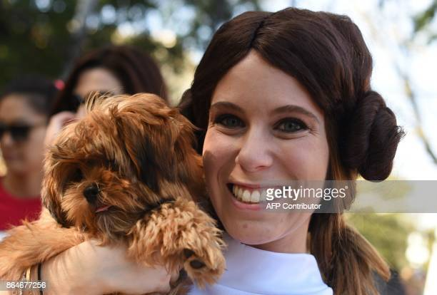 A woman poses with her dog in costume during the 27th Annual Tompkins Square Halloween Dog Parade in Tompkins Square Park in New York on October 21...
