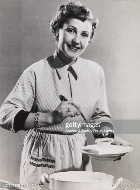 Woman poses with ladle and soup bowl 192060 Photographic archive of Photographic Advertising Limited Comprising stock sheets individual images guard...