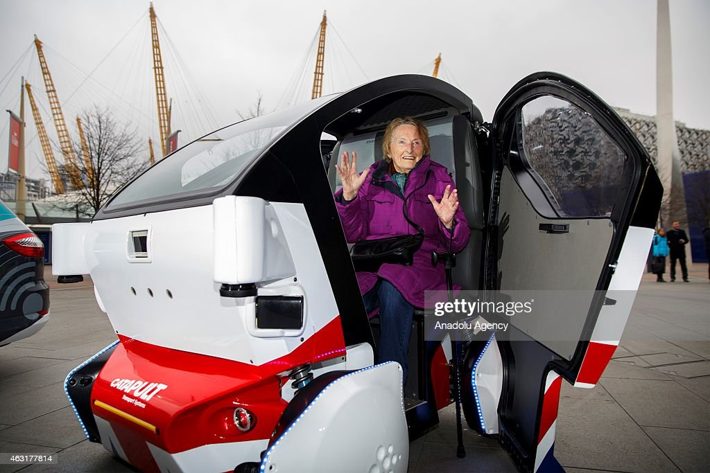 A woman posing in a Pathfinder Pod, a driverless car made by UK Autodrive in Milton Keynes at Peninsula Square in London, England on February 11, 2015. On Wednesday 11 February, Transport Minister Claire Perry and Business Secretary Vince Cable announce the outcome of a regulatory review undertaken to establish the framework to support the testing of driverless cars in the UK and officially launch three driverless car trials.