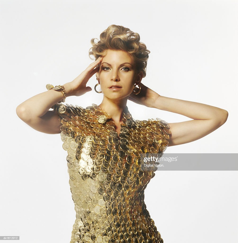Woman Posing in a Shirt made from Gold Coins : Stock Photo