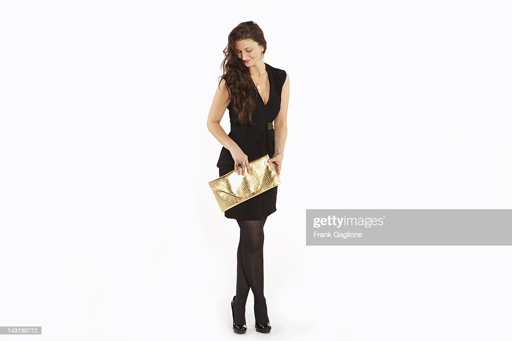 Woman posing in an outfit. : Stockfoto