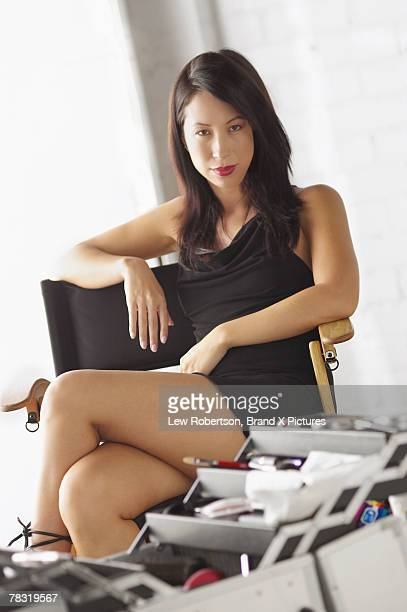 Woman posing in director's chair