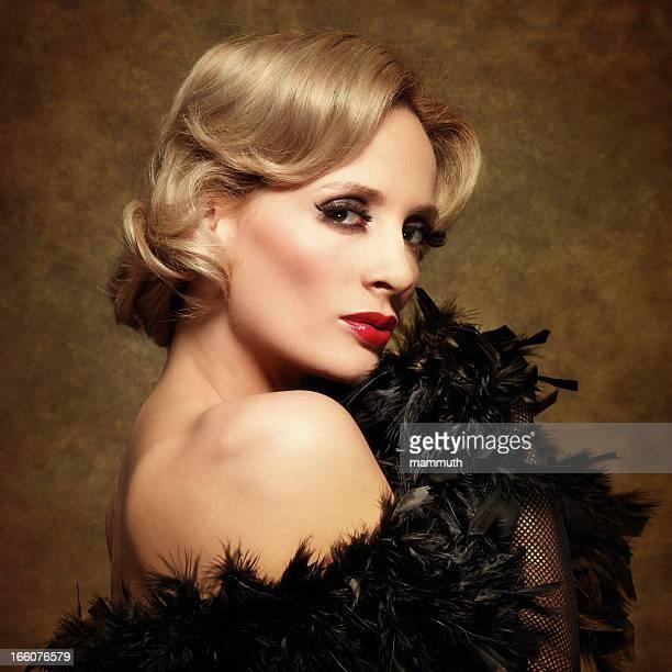 woman posing in feather boa - retro style